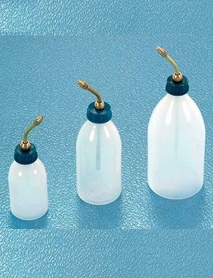 Handy oil bottles with brass spouts for precision application